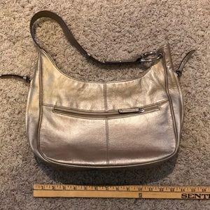 Tignanello gold leather bag.